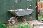 Old steel wheelbarrow — Stock Photo