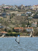 Windsurfing at san roque lake, cordoba, argentina — Stock Photo