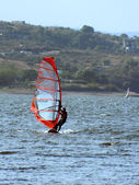 Windsurfing at San Roque lake — Stock Photo