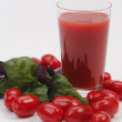 Stock Photo: Glass of juice with tomato and basil