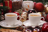 Christmas still life with tea and biscuits — Stock Photo