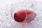Glass of red wine on the ice cubes — Stock Photo