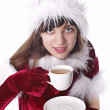 Christmas Santa girl drinking tea — Stock Photo