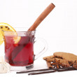 Glass of mulled wine with pepper cookies — Stock Photo