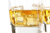 Glass of whisky with ice — Stock Photo