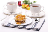 Biscuit with jam and teacup — Stock Photo