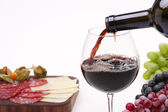 Pour the wine into a glass — Stock Photo