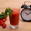 Stock Photo: Tomato juice and clock