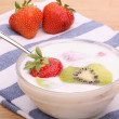 Strawberries with kiwi in the yogurt — Stock Photo