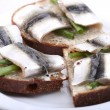 Baltic sprat on the bread — Stock Photo