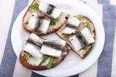 Baltic sprat on the bread — Stock Photo