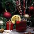 Mulled wine with spice and christmas tree — Stock Photo