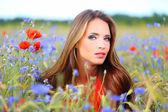 Cute woman on flower field — Zdjęcie stockowe