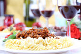 Pasta bolognese with basil and wine — Stock Photo