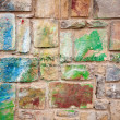 Stone wall with colorful spots — Stock Photo