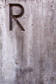 Letter R on Concrete Vertical — Stok fotoğraf