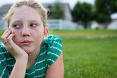 Young girl looking bored — Stock Photo