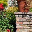 Flower pot Planter on Stone foundation — Stock Photo
