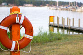 Lifebuoy at a boat put in. — Stock Photo