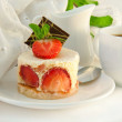 Cake from cream and a strawberry — Stock Photo #11449357