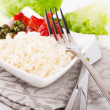 Rice with green-stuffs on festive table — Stock Photo #12375390