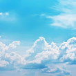 Stock Photo: White clouds on dark blue sky in sun day