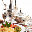 Couscous with green-stuffs and Arabic tableware - Stock Photo