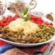Stock Photo: Couscous with green-stuffs and Arabic tableware
