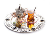 Turkish tea and sweets in decorative ware, candies — Stock Photo