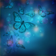 Flight of butterflies is in the rays of light — Stock Photo #16250947