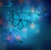 Flight of butterflies is in the rays of light — Stock Photo