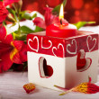 Red candle with heart and flower, a Valentine's Day card - Foto Stock