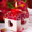 Red candle with heart and flower, a Valentine's Day card - Stock Photo