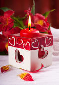 Red candle with heart and flower, a Valentine's Day card — Stok fotoğraf