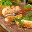 Stock Photo: Fresh bread and butter on wooden board