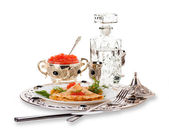 Pancakes with red caviar on silver ware — Stock Photo