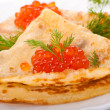 Stock Photo: Pancakes with red caviar on silver ware