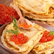 Stock Photo: Pancakes with red caviar on wooden ware