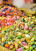 Multi-colored heap of spices from plants and flowers — Stock Photo