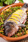 Baked crucian on a pillow from lentil and peas — Stock Photo