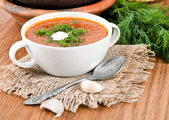 Borsch, soup from a beet and cabbage with tomato sauce. — Stock Photo