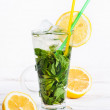 Stock Photo: A glass of mojito cocktail with mint, lemon and ice