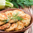 Stock Photo: Green zucchini pancakes on a wooden old board
