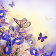 Stock Photo: Bouquet of blue irises, white flowers and butterfly