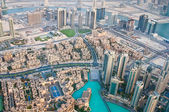 DUBAI, UAE-JUNE 7: View of the city from the observation deck Burj Khalifa the highest building in the world on June 7, 2013 in Dubai — Stock Photo