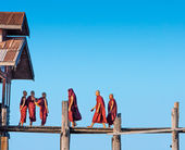 Monks crossing the river — Stock Photo