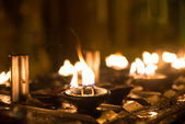 Ritual candles in Shwedagon Pagoda — Stock Photo
