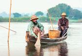 Fishermen with fish — Stock Photo