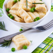 Stockfoto: Cheese gnocchi with peas and rosemary