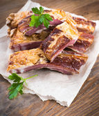Smoked ribs with parsley leaves — Stock Photo